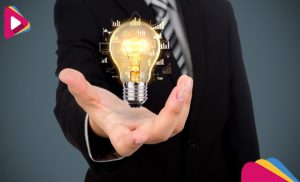 businessman with a light bulb in his hand 1232 891